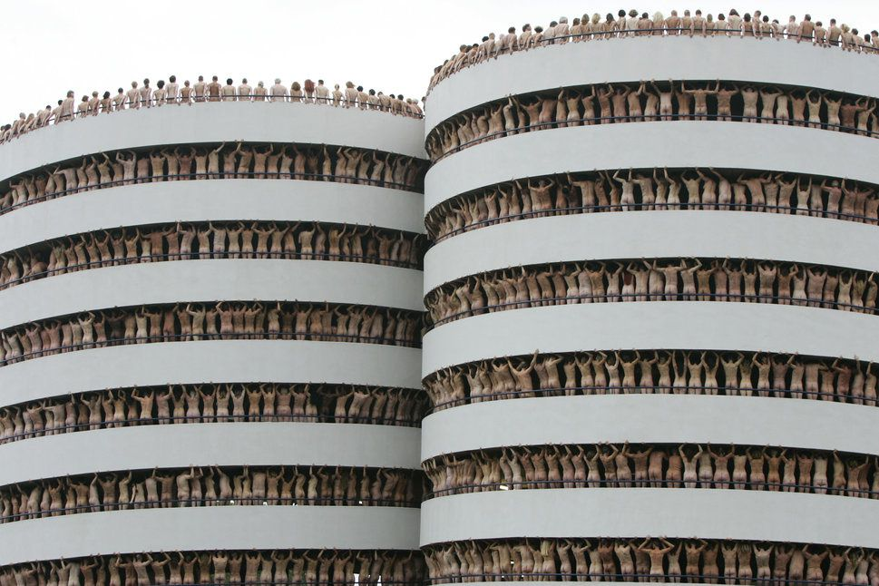 Naked volunteers pose for U.S. photographer Spencer Tunick in the Europarking building in Amsterdam on June 3, 2007.