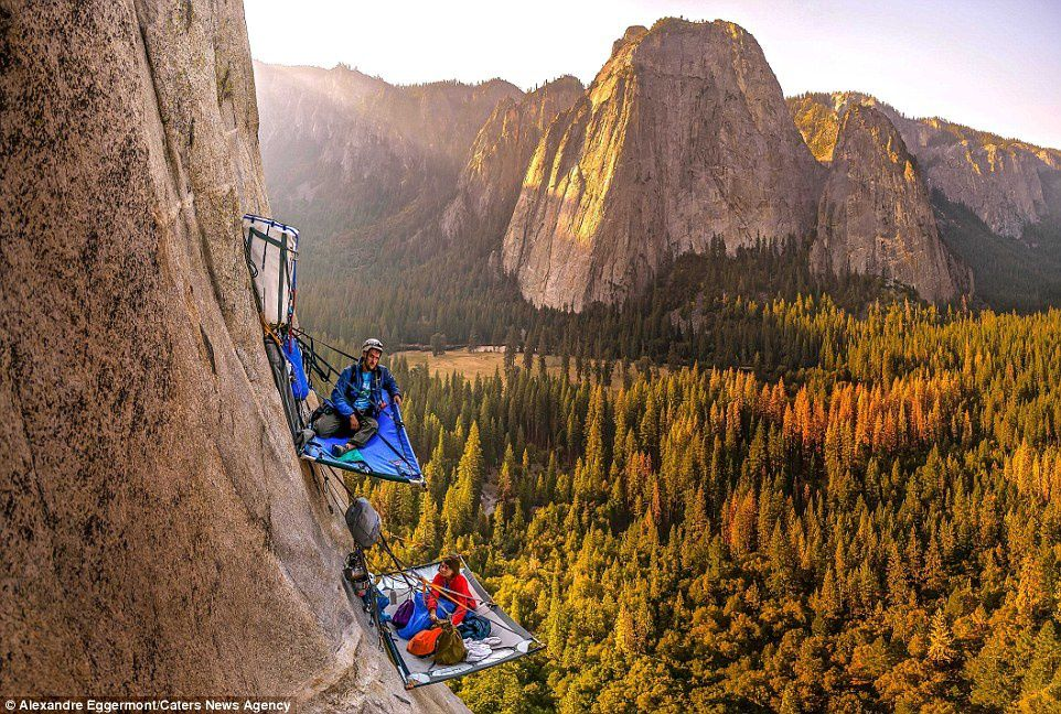 Nice place for a picnic? Morgane Choquet and Samuel Cobb relax in a vertical campsite on the slopes of vertical rock formatio El Capitan in Yosemite National Park, California