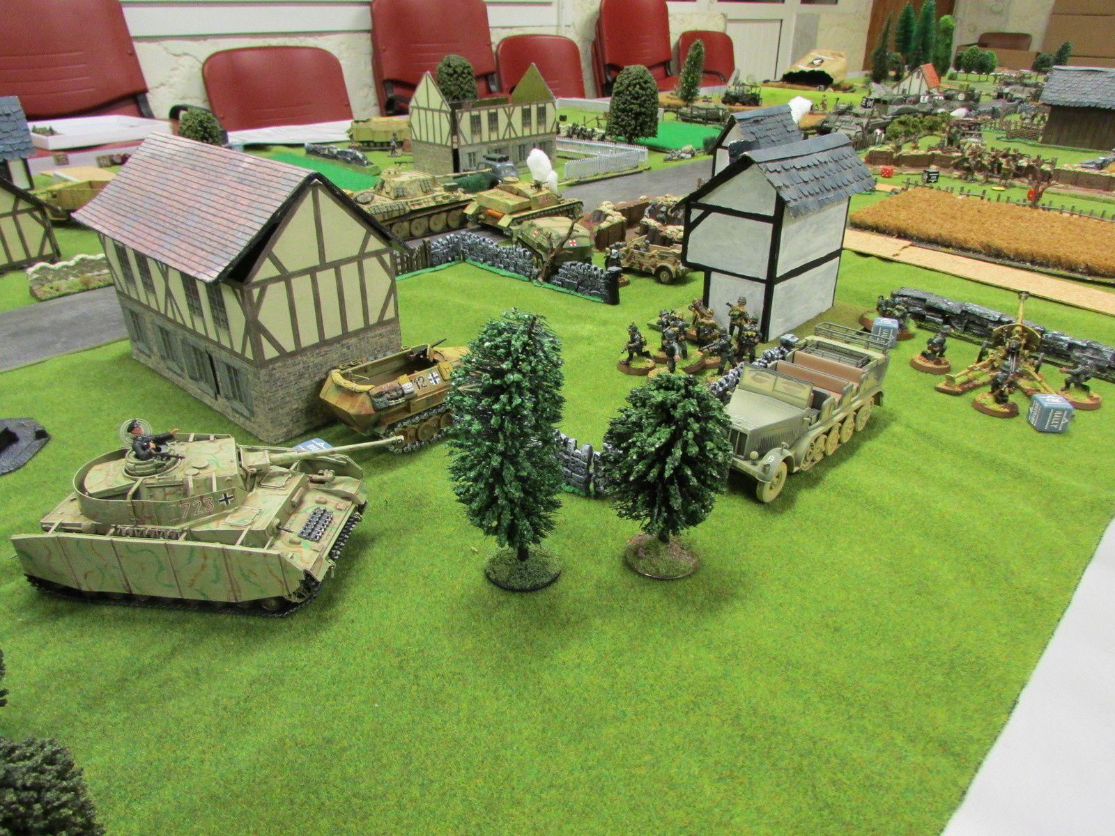 Un plan large des lignes arrière allemandes laisse à penser que le plus dur restait à faire pour les Ricains, même si à cet instant de la bataille, leur victoire en matière de perte est totale.