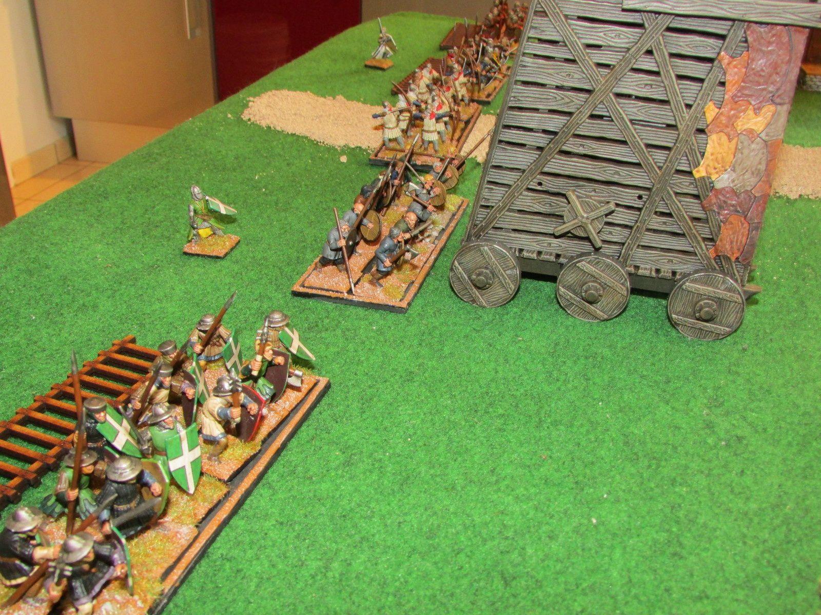 Le Comte de Devon et le Duc de Winchester quant à eux prennent place et dressent une tour de siège pour accélérer les discutions...