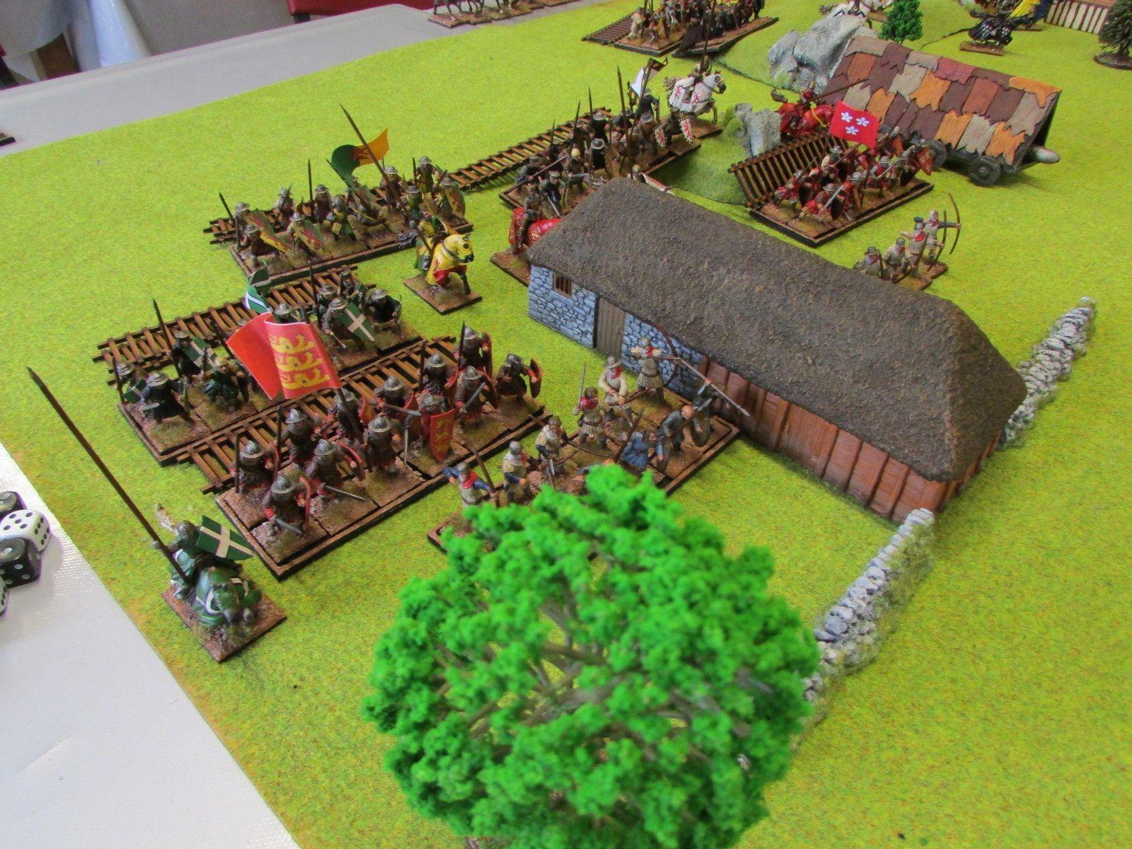 L'armée du roi avance sous les tirs des archers qui ne touche quasiment rien.