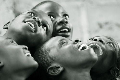 a smile is cheaper than electricity, but gives as much light