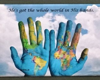 THE WORLD IN HIS HAND