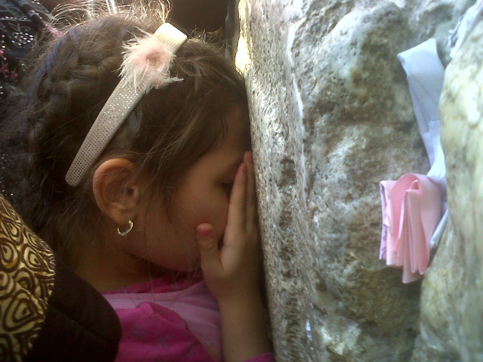 Little girl praying at the western wall