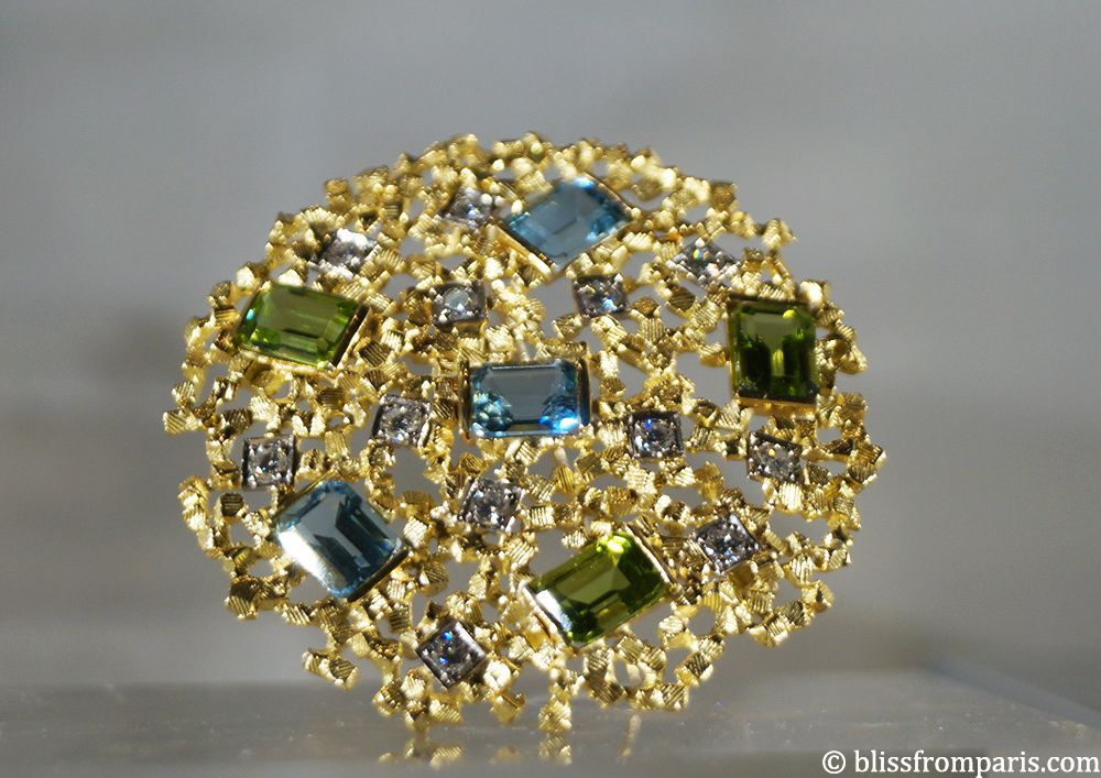 John Donald- Broche de 1986 (or jaune,diamants, péridots, aigue-marines)