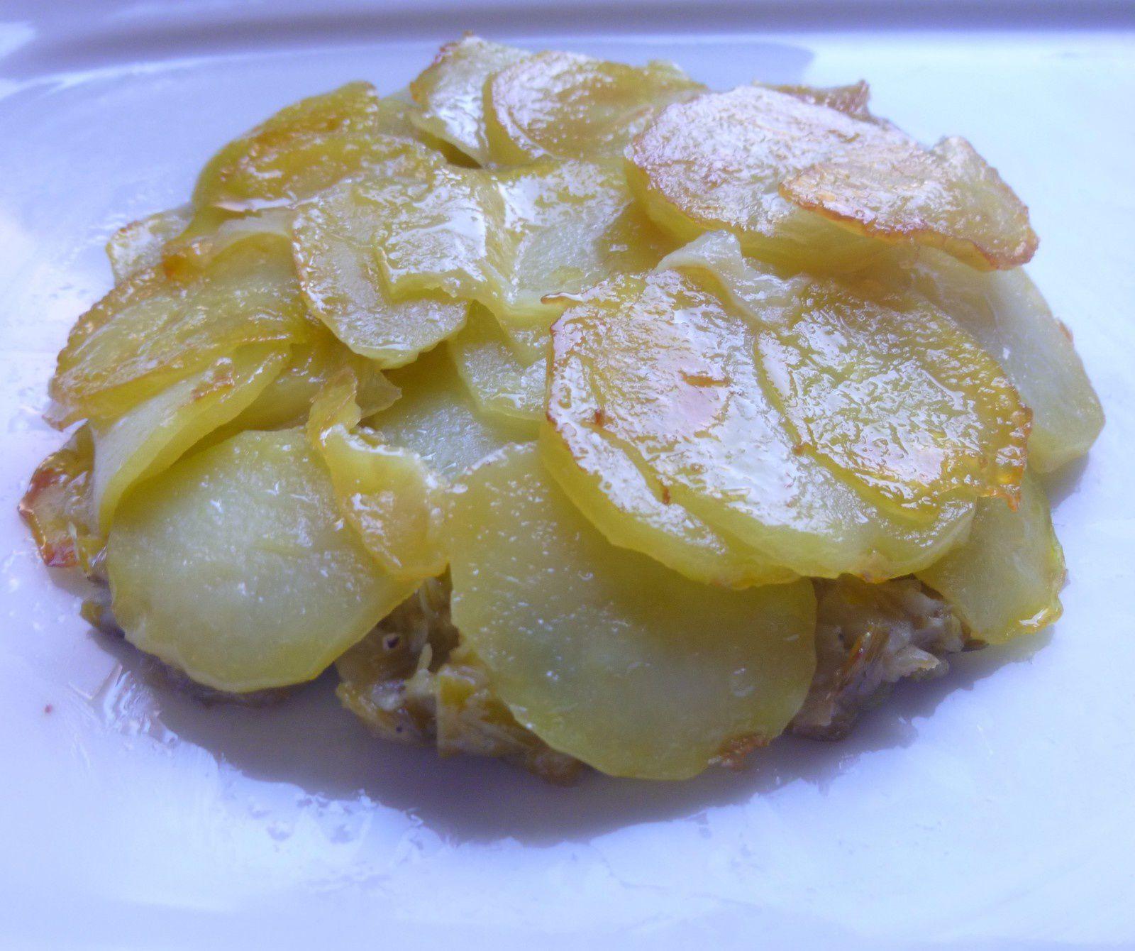 tatin de fondue d'endives/poireaux,roulés de sole/St-Jacques à la sauce citronnée