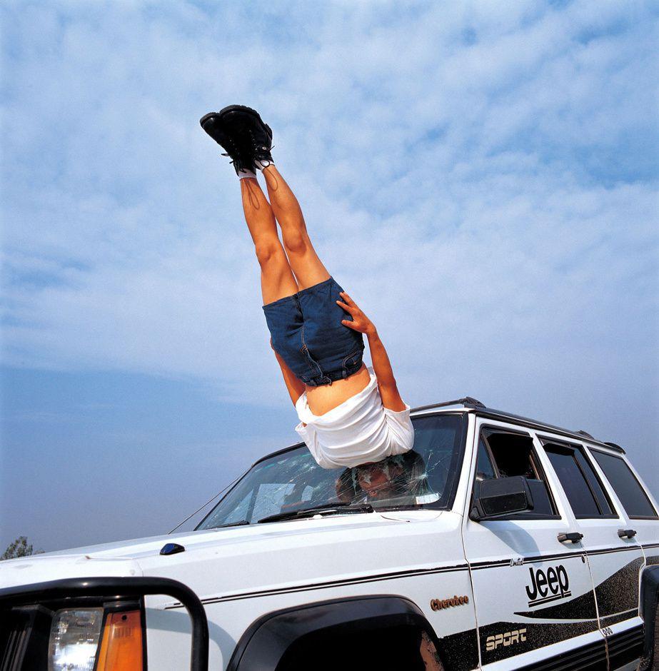 LI WEI falls to the car, 2003
