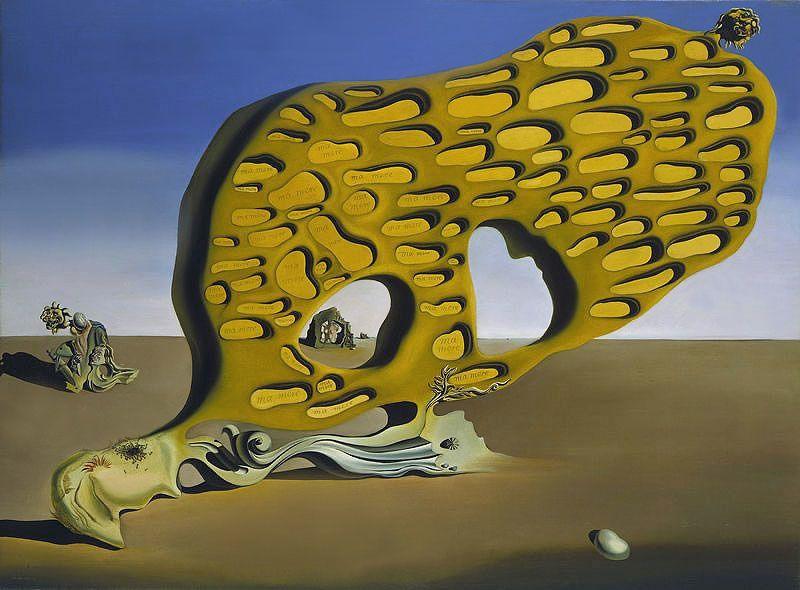 """Énigme du désir : ma mère, ma mère, ma mère. Description  """"L'oeuvre représente un lieu désertique, où pouvait se trouver jadis un océan, et exhibe un visage en proie à la décomposition et auquel est amalgamée une concrétion rocheuse. A l'intérieur de celle-ci, on distingue des alvéoles, dont certaines comportent l'inscription « ma mère ». A droite, le bloc se dresse vers le ciel et se termine par une tête de lion. La base de l'ensemble propose des volutes Art Nouveau tandis qu'à l'arrière-plan, tels des débris, figurent des assemblages hautement symboliques. Sur la gauche : une accolade d'un fils à son père, entourée par une tête de lion, un faciès d'aliéné, une sauterelle et une main brandissant un couteau. Au fond : un rocher comprenant en partie un nu féminin."""". Date  1929 Format  110 cm X 150 cm"""