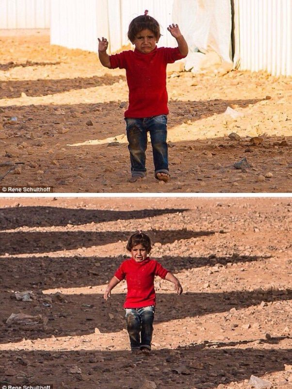 Syrian child mistakes a photographers camera for a weapon and raises her hands to 'surrender'