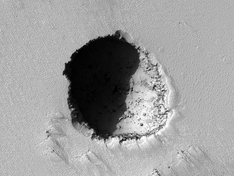An alcove / skylight on a lava tunnel of Pavonis Mons - NASA / THEMIS image from the Mars Odyssey orbiter