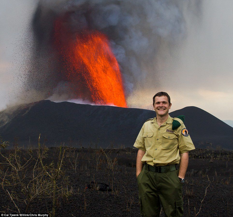Emmanuel de Merode with the Nyamuragira in, eruption on 13.11.2011 - photo Gorilla CD / Virunga National Park