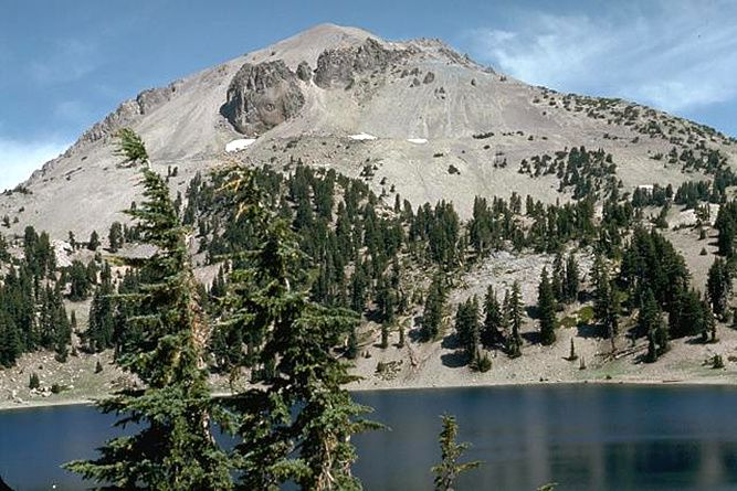 The Lassen Peak seen from Lake Helen - caps of black dacite rocks emerge from the clearer dome - photo Lee Siebert 1972