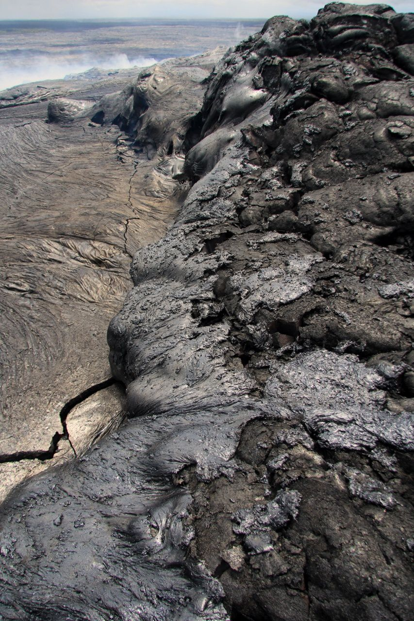 Pu'u O'o - 06/27/2014 - spatters of fresh lava covering older flows at the breakout - photo HVO