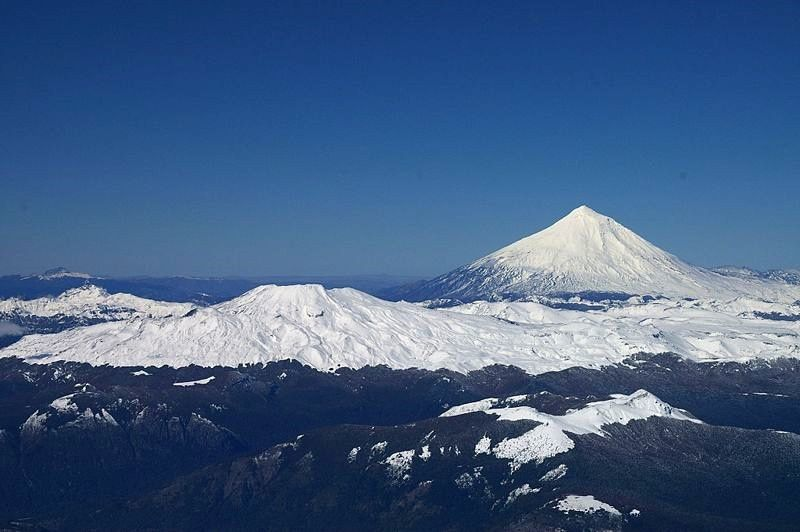 to the left, the volcano Quetrupillan - to the right, Lanin volcano - photo Ben Tubby