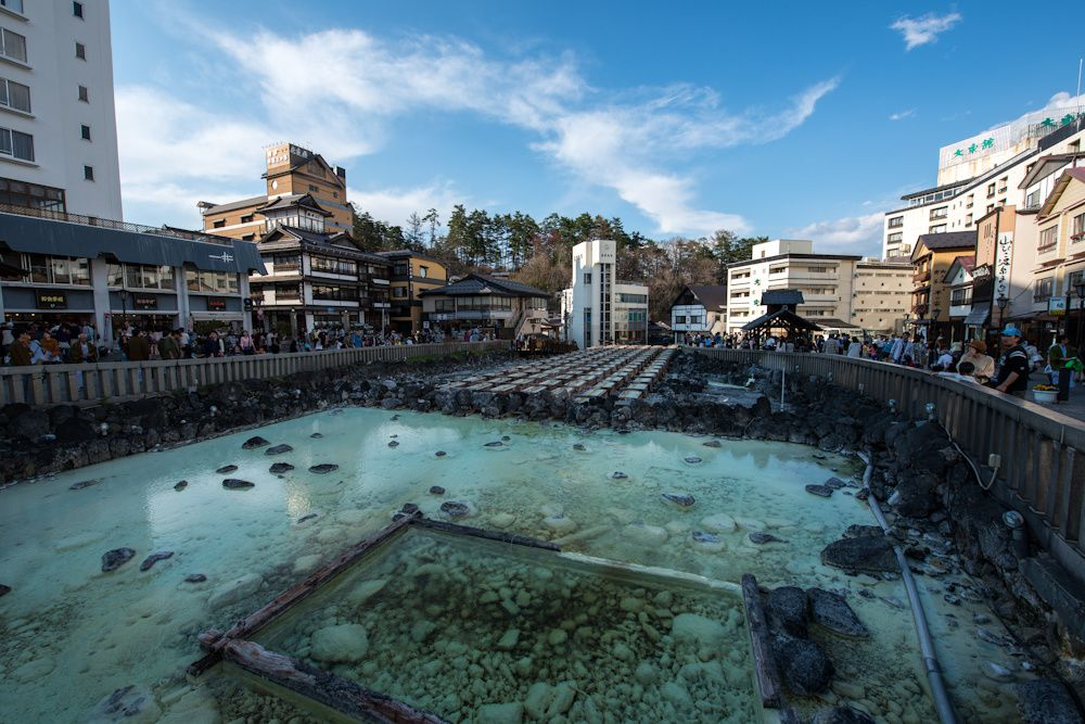 Kusatsu - South Side of Yubatake - Wood features of the upper pool to cool the hot springs and collect sulfur powder. - Photo Muikabochi