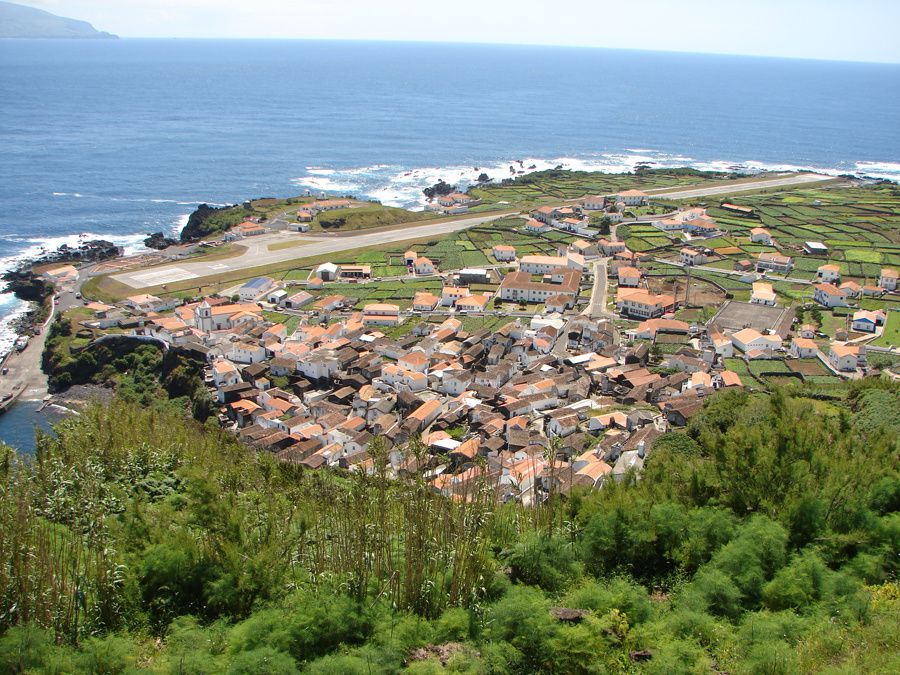 Corvo / Azores - Lava Delta / fajã lavica, to  the south of Corvo, houses the airstrip and houses - photo Geoparque Azores