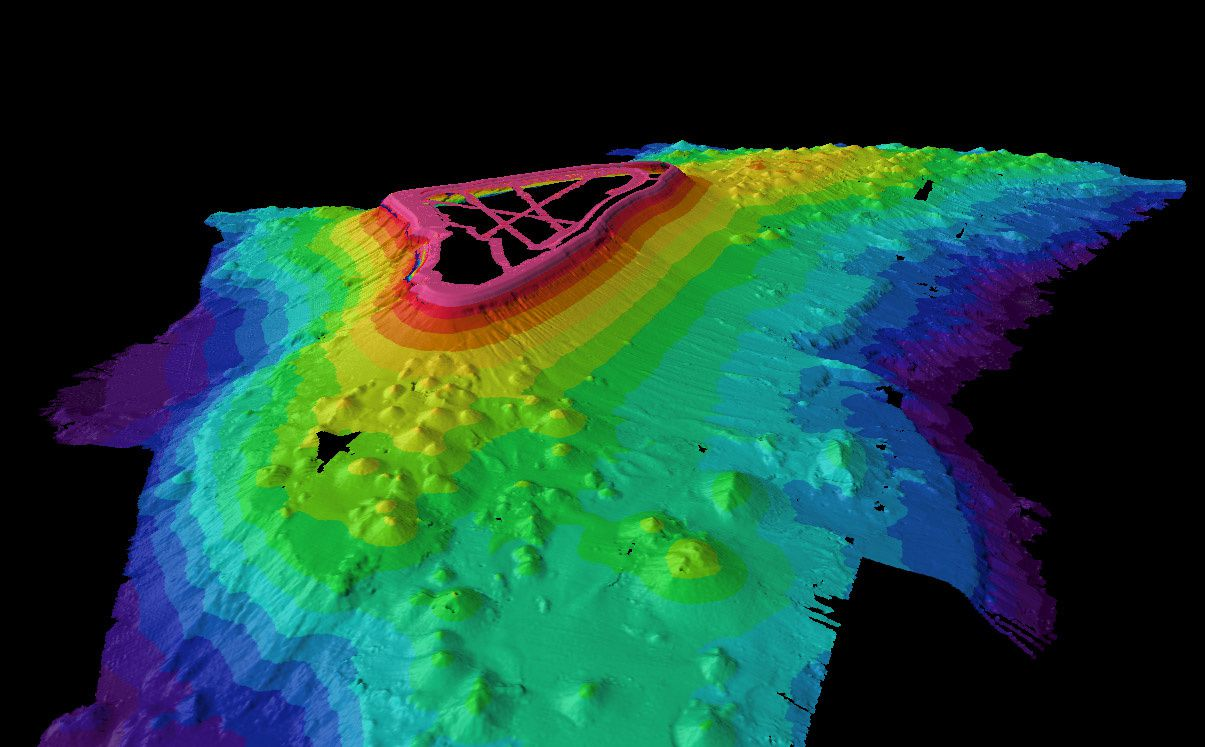 Kingman reef - 3D image of the bathymetry - note the conical structures on the sides - only a few passages were carried out on the lagoon (pink lines) - http://www.soest.hawaii.edu