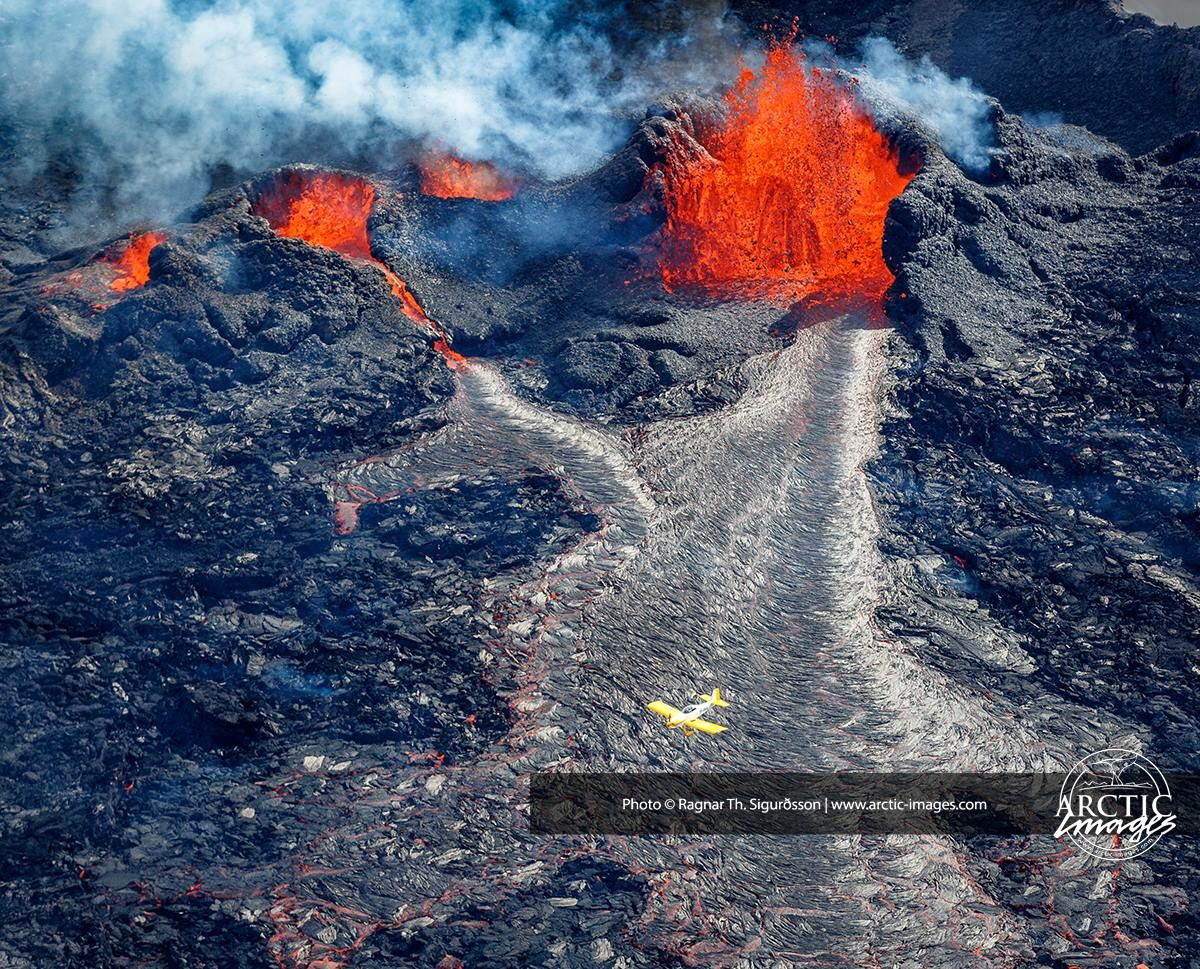 The fissure in Holuhraun - a plane in down center for scale - photo Ragnar Sigurdsson / Arctic Images