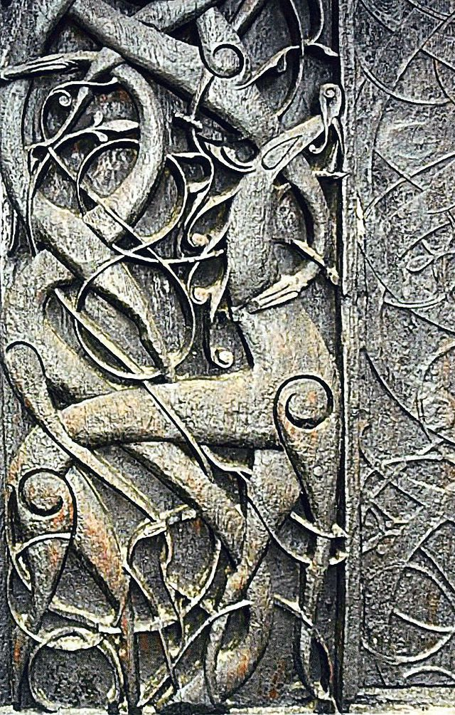 The north portal of the eleventh century Urnes Stave Church has been interpreted as containing scenes of snakes and dragons representing Ragnarok - photo Nina-no.