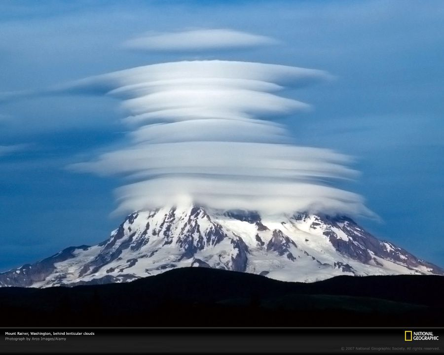 Stack of lenticular clouds on Mt.Rainier - National Geographic Photo / Arco images.
