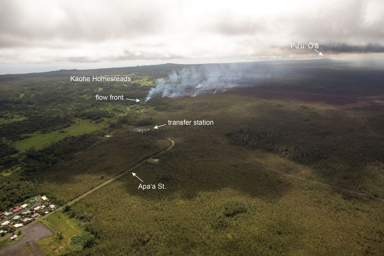 East Rift Zone - View of the site of the 27 June's lava flow, from its origin on the slopes of Pu'u O'o to the lava front, near Apa'a st. The residential area of Pahoa is partially visible in the left corner. - Photo HVO