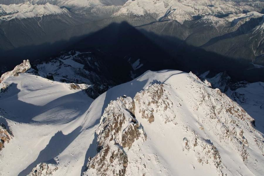 The summit of Glacier Peak and its shadow - photo John Schurlock / USGS