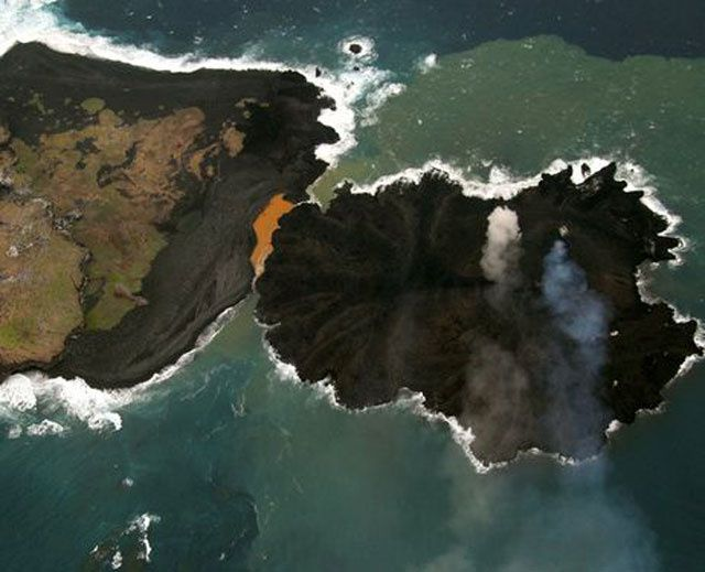 "Nishino-shima, left, separated from Niijima, right, through a narrow channel - Territorial fusion is coming, and the appellation ""volcano"" could be changed to ""adventitious cone"" - 12.24.2013 / JCG."