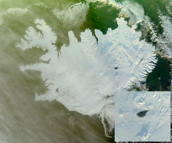 The Holuhraun dark lava field slice of on a completely white snowy and icy Iceland - Doc. Nasa