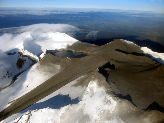 Aerial view of the summit of Ruapehu September 26, 2007, days after a brief eruption. Crater Lake on the left, covered the top of ash and mud, and spawned a major lahar down the Whangaehu glacier (center) and another smaller one at the outlet of the lake in a gully (far left) - Photo courtesy of GeoNet 2007