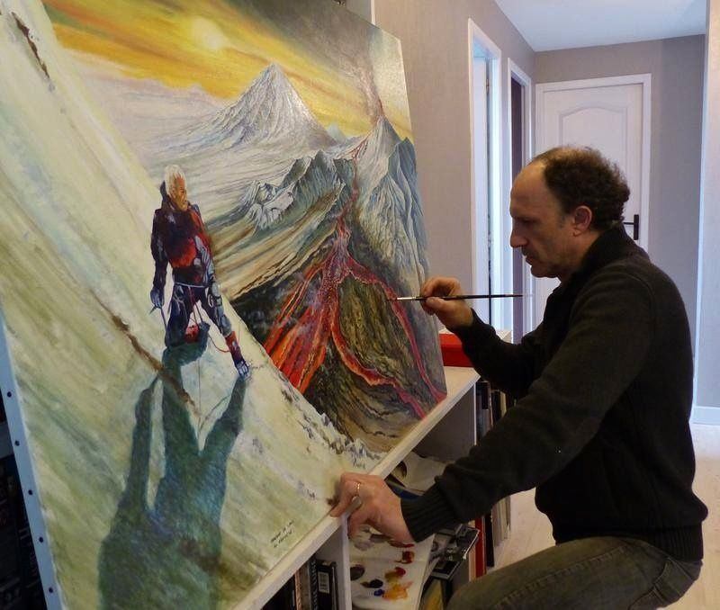 The artist, Jocelyn Lardy, at work in front of his large canvas.