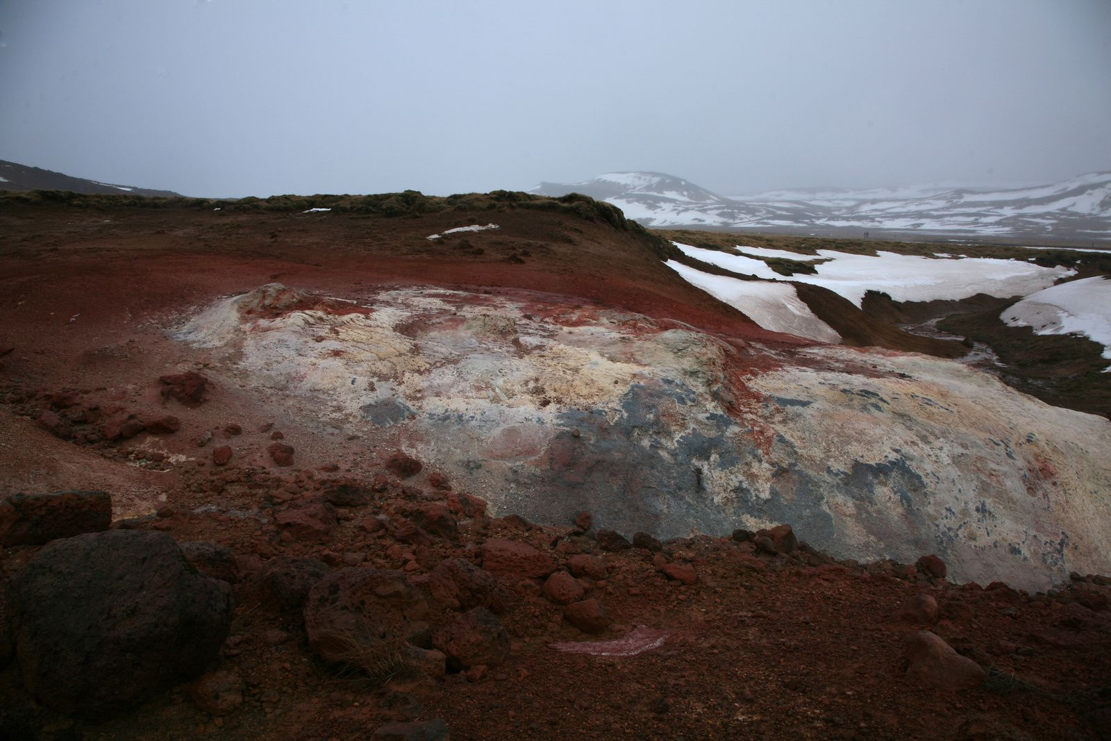 The geothermal field Krísuvík-Seltun - tone agreements between weathered, oxidized rocks and the leaden sky - photo © 2015 Bernard Duyck