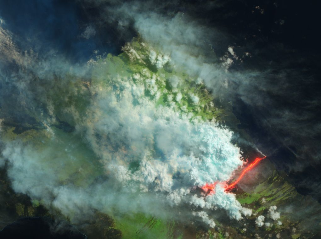 Despite extensive cloud cover, the Advanced Land Imager (ALI) on the Earth Observing-1 satellite acquired this view of lava flowing into the ocean on May 28, 2015. The false-color image combines shortwave infrared, near infrared, and green light (ALI bands 9-7-4). Clouds appear blue-white, while liquid water is dark blue. Vegetated areas are green&#x3B; old lava flows are brown. Fresh lava is bright orange and red.