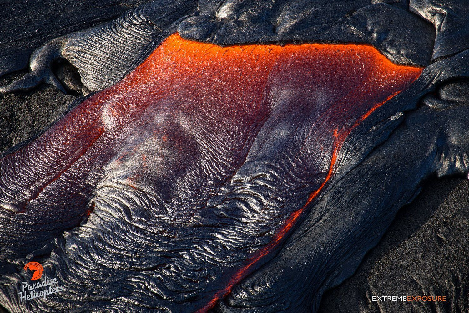 Pu'u O'o - A recent breakout near the distal tip of the casting lets out lava that covers an old cast - photo Bruce Omori / Paradise Helicopters
