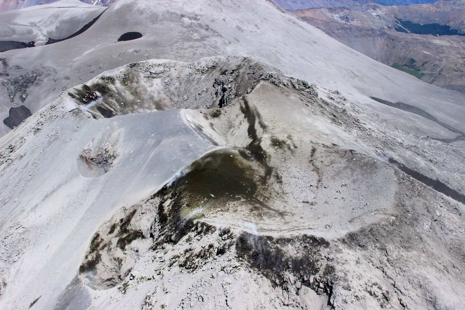 "Summit craters of Nevados de Chillan - from front to back, the Nuevo crater, with at his left, the Crater of January 8 - after, the crater formed in 2003, in the background, the Arrau crater, with the ""new crater"" on its side under the left edge of the crater - photo SERNAGEOMIN"