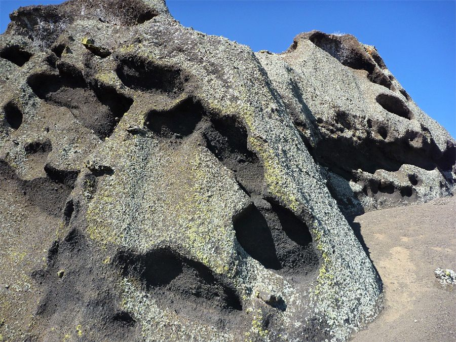 Red Mountain  - Weathered formation of fused cinders, mostly covered by lichen - amerSW