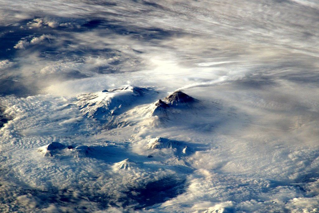 The volcanic group Klyuchevskoy seen from the international space station by the astronaut Tim Peake -  18.4.2016: the snow has melted on the active cone