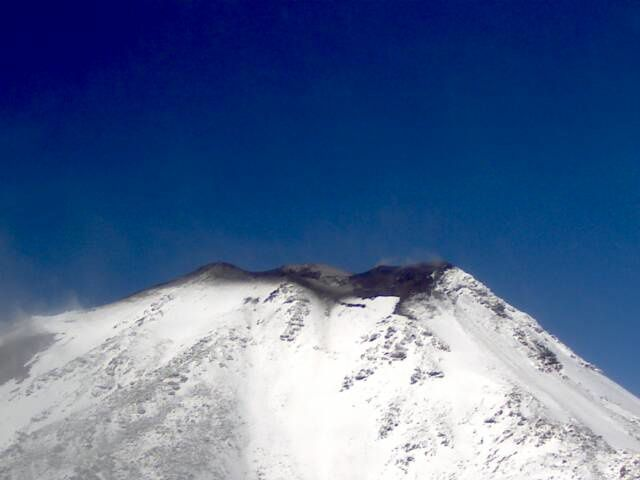 Nevados de Chillan - ash emissions mark the snowy summit area - Portezuelo webcam / SERNAGEOMIN