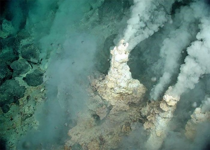 Drops of liquid carbon dioxide out of adjacent fractures in white smoking chimneys on the Champagne field  / Eifuku seamount - Image courtesy of the NOAA Vents Program