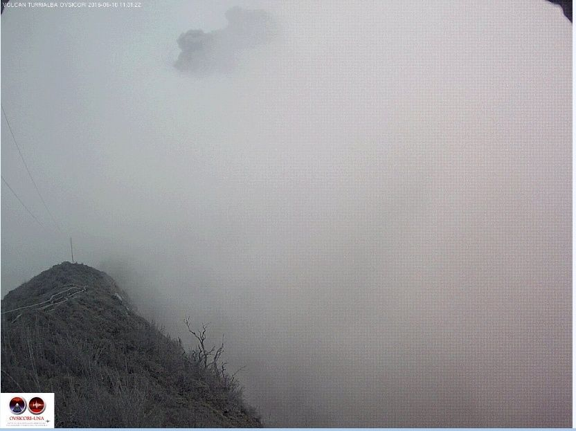 Turrialba 10.06.2016 - the summit in fog permits rather the eruptive plume (partly left top of the photo) - webcam Ovsicori