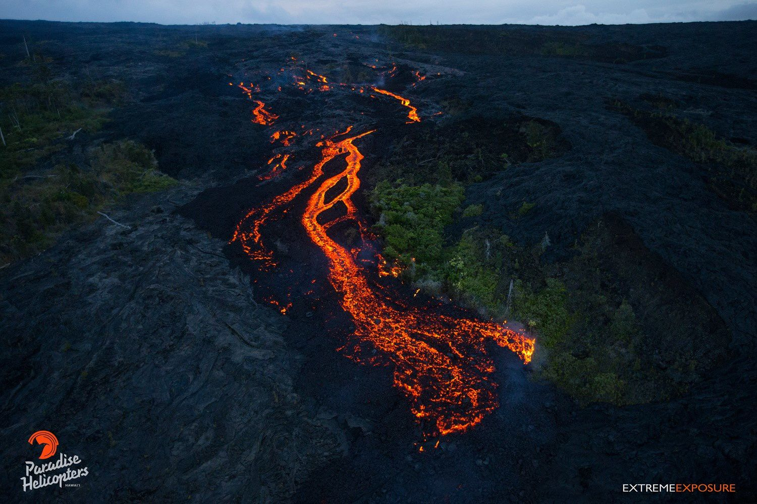 Lava flow channeled from the Pu'u O'o on the Pali Pūlama 06/28/2016 - Picture Paradise Helic.