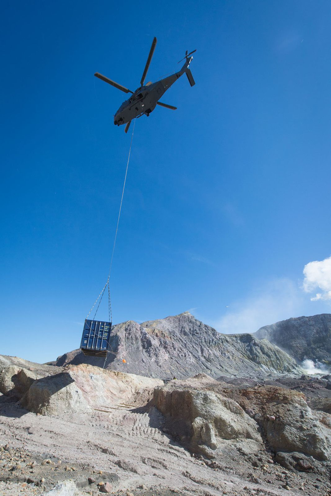 White island - A container is supplied through the air to provide shelter - photo NZ Herald