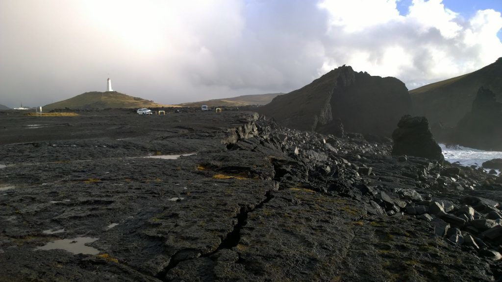 The site of the IDDP-2 to the left of the lighthouse of Reykjanes. - photo IDDP