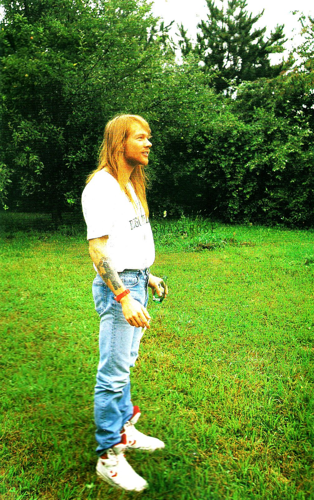 Axl Rose 1992 - Axl in his hometown of Lafayette, Indiana, July 23, 1992. The trees in the background were planted by Axl, his brother Stuart, and his sister Amy.
