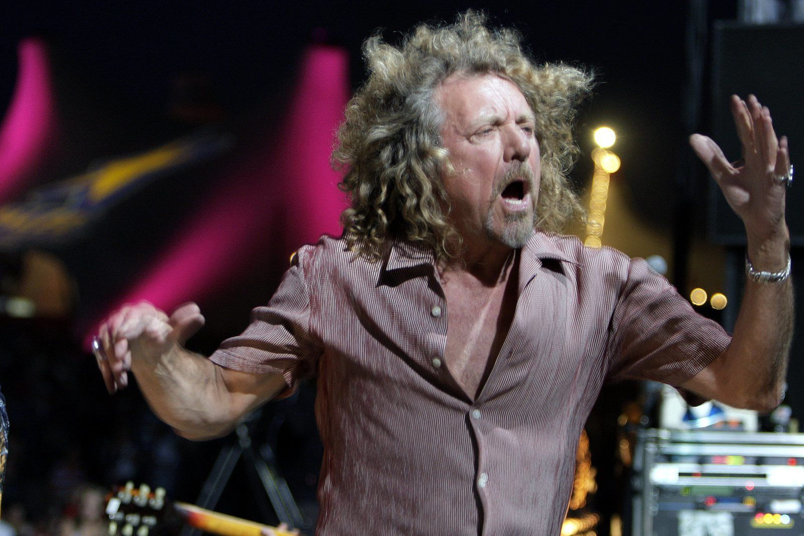 Robert Plant - Plant's golden mane was at its aging-rocker best in this 2005 concert appearance in Switzerland - AP PHOTO