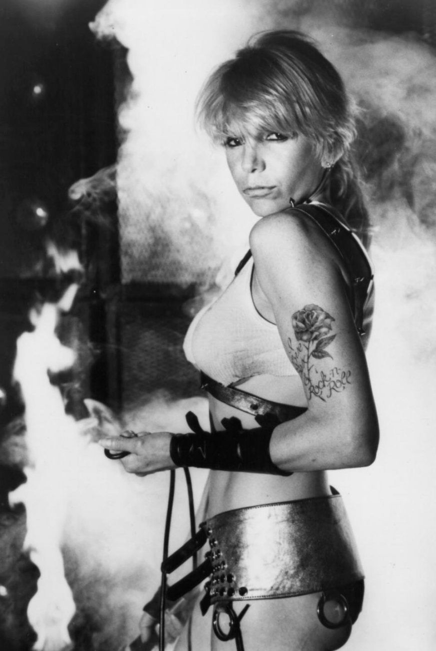 Wendy O. Williams - Rock and Roll tattoo on her left arm