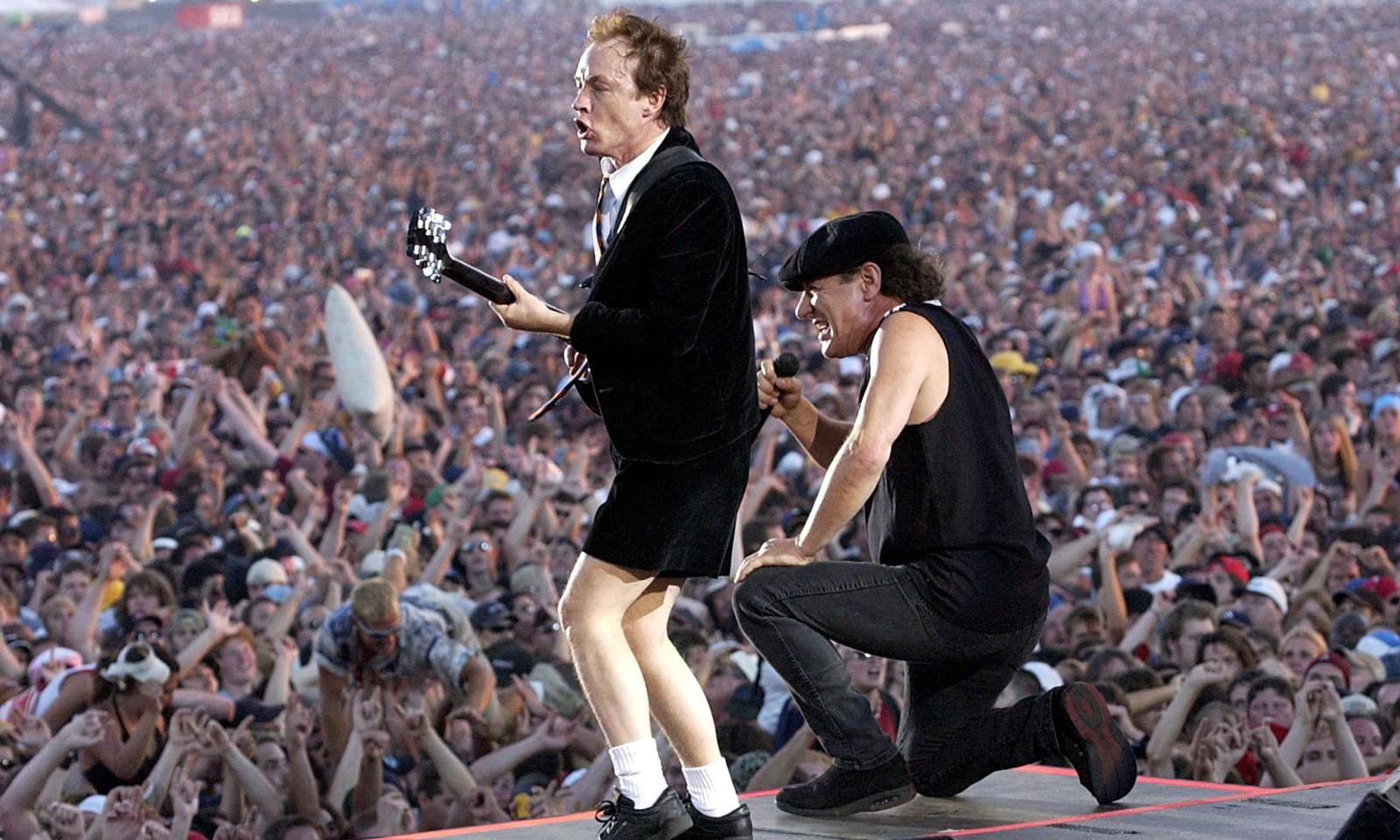 AC/DC lead vocalist Brian Johnson (L) and Angus Young perform at the O2 Millennium Dome stadium in London April 14, 2009