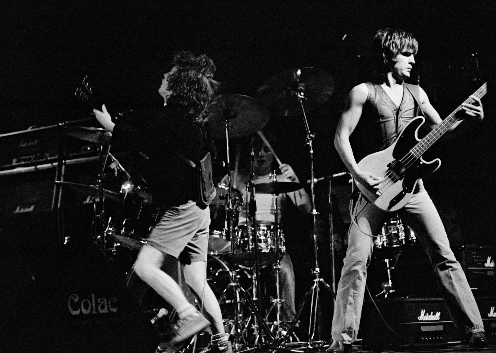 Angus Young and Mark Evans on stage - AC/DC, late 70s