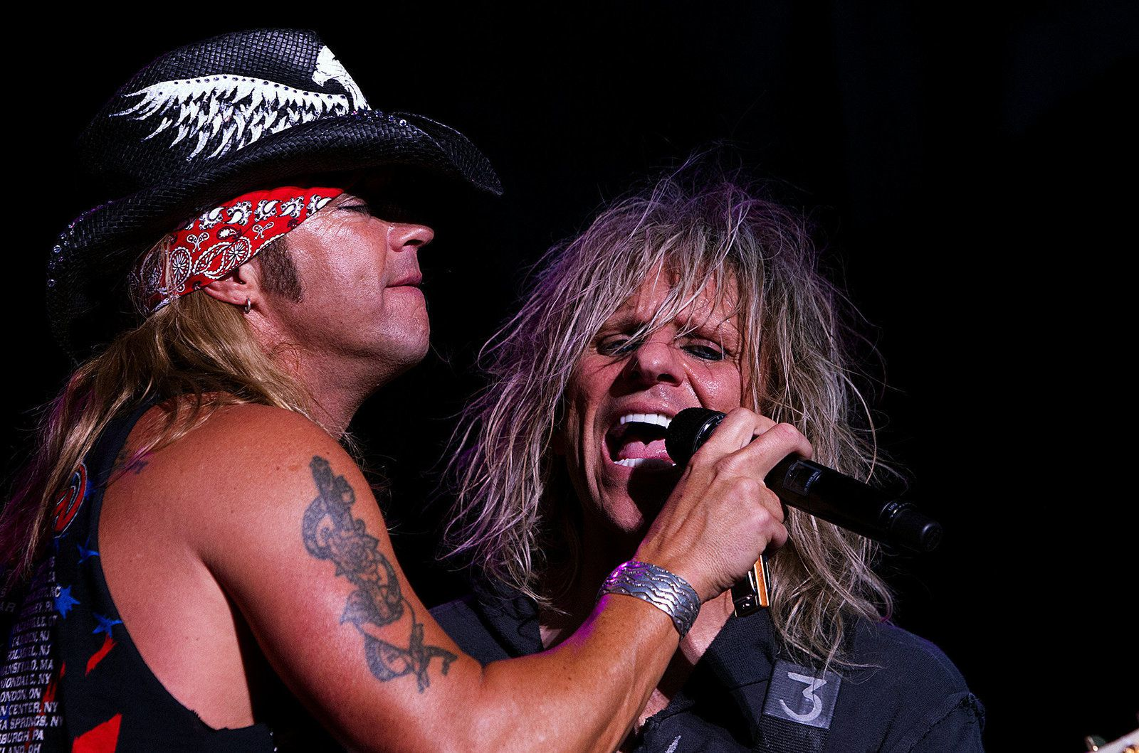 Poison's Bret Michaels and C.C. DeVille perform during the Rock of Ages Tour at Hersheypark Stadium (August 15, 2012)