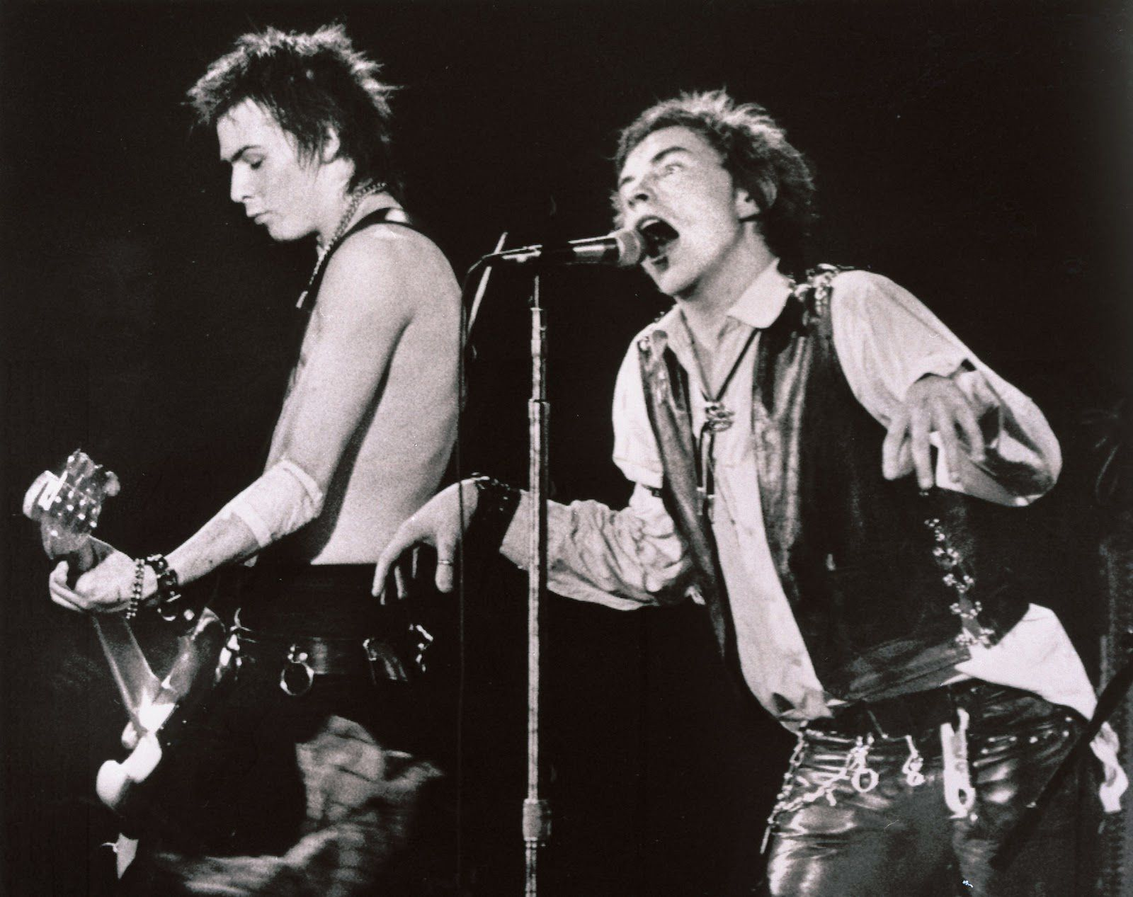 Johnny Rotten and Sid Vocious (Sex Pistols) on stage (1978)