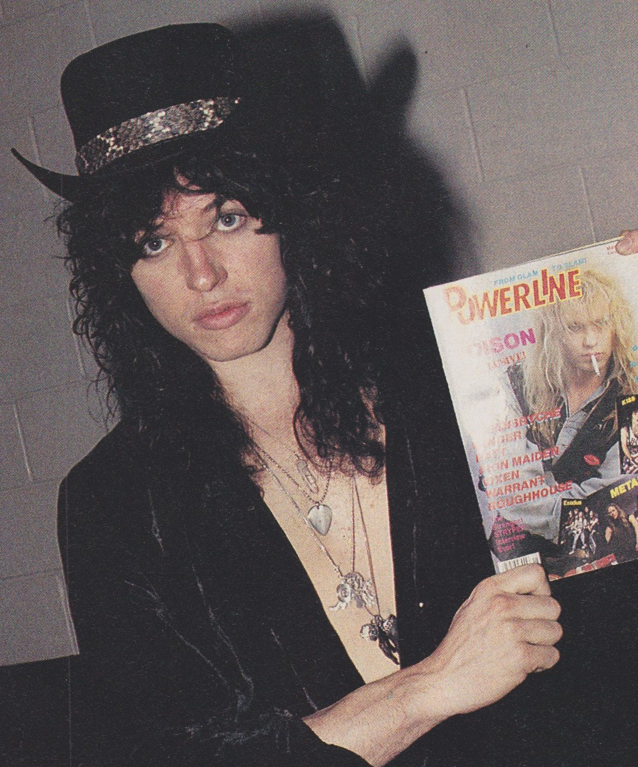 Tom Keifer, Cinderella with a copy of Powerline Magazine (1989)